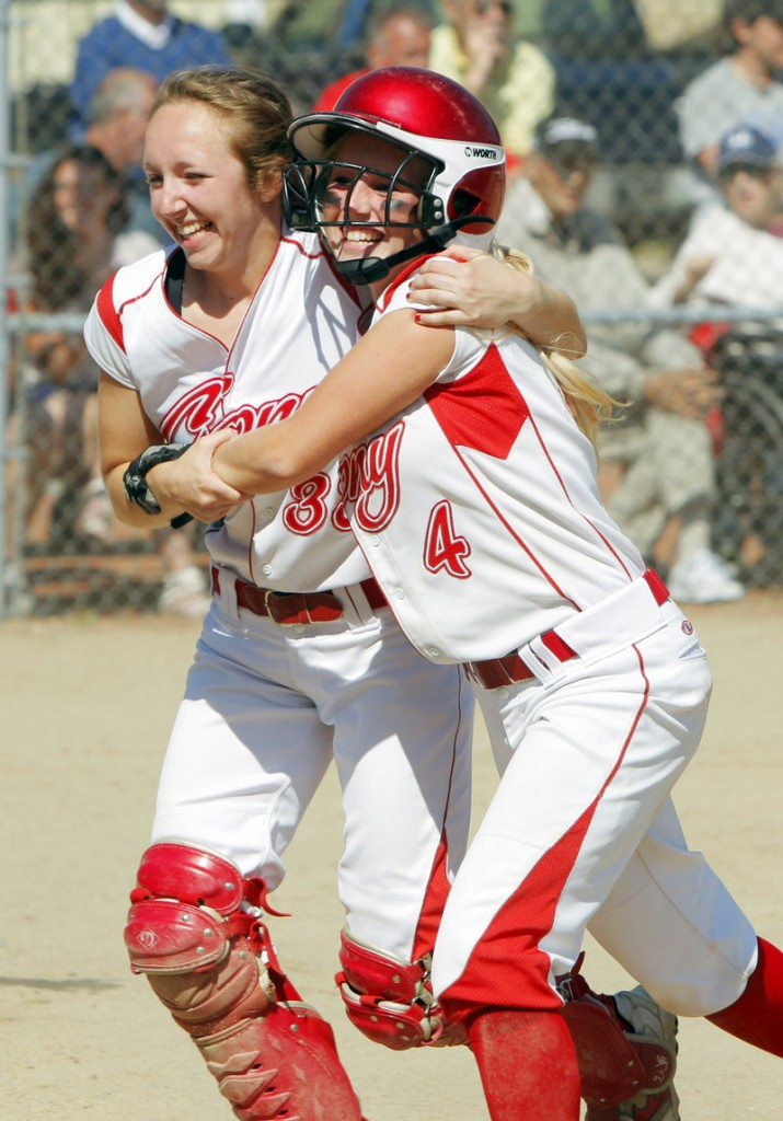 Nicole Rugan, left, hugs Alyssa Brochu after Brochu scored the second run for Cony in the fourth inning Saturday. The Rams went on to beat South Portland 2-0 and capture the Class A softball state championship.