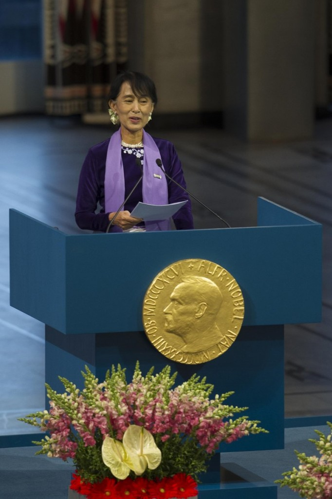 Myanmar opposition leader Aung San Suu Kyi gives her Nobel Peace Prize speech at the city hall in Oslo on Saturday as she formally accepts the prize that thrust her into the global spotlight two decades ago.