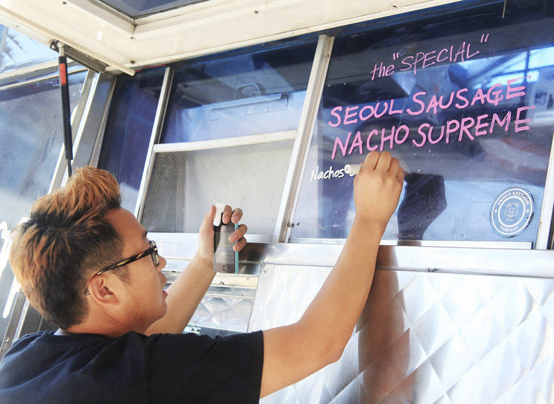 Yong Kim writes specials at the Seoul Sausage truck.