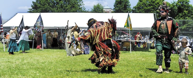 Participants clad in American Indian regalia dance Sunday during the Honoring Our Veterans Powwow at Togus.