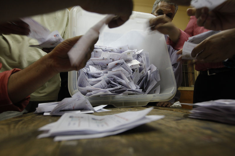 Egyptian election officials count ballots at a polling center in Cairo on Sunday during the second day of the presidential runoff. Final official results aren't expected until Thursday.