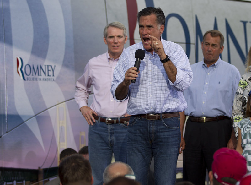 Republican presidential candidate Mitt Romney speaks at a campaign stop in Troy, Ohio, on Sunday.