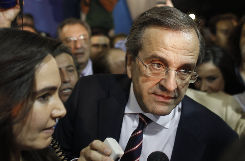Antonis Samaras, leader of the New Democracy conservative party, speaks to supporters in Athens on Sunday. His party is likely to stick to austerity measures.
