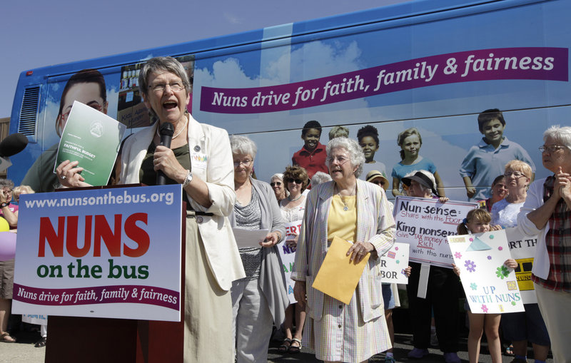 Sister Simone Campbell, executive director of Network, speaks during a stop on the first day of a nine-state Nuns on the Bus tour, on Monday in Ames, Iowa.