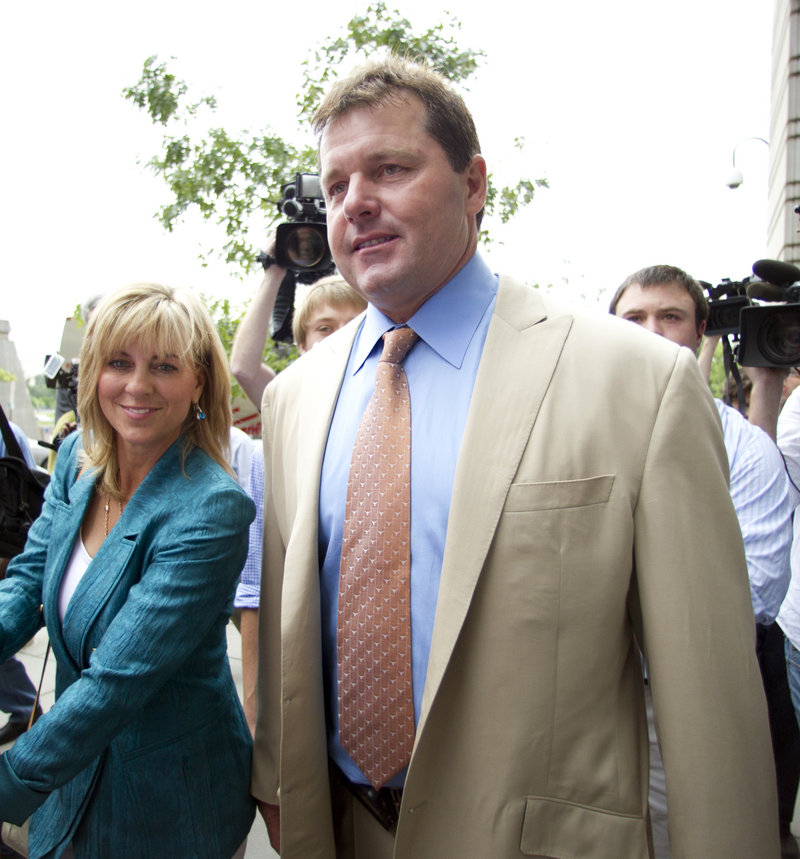 Former Major League Baseball pitcher Roger Clemens and his wife, Debbie, walk outside federal court in Washington on Monday. He was acquitted on charges of lying to Congress in 2008, when he denied ever using performance-enhancing drugs.