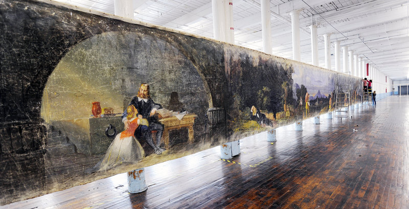 "A section of the 800-foot muslin scroll ""Moving Panorama of Pilgrim's Progress"" goes up in the cavernous former loom room at the Pepperell Mill complex in Biddeford."