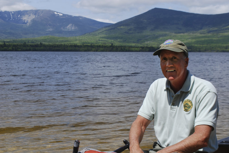 Jensen Bissell, the Baxter State Park director, is in the process of surveying and considering the land at Painters' Beach on Katahdin Lake that looks to Mount Katahdin.