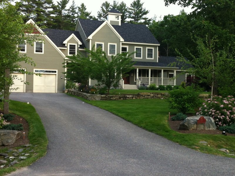 Falmouth police say Barry and Paula Spencer, the owners of this house at 35 Fieldstone Drive, have been charged with furnishing a place for minors to drink alcohol.