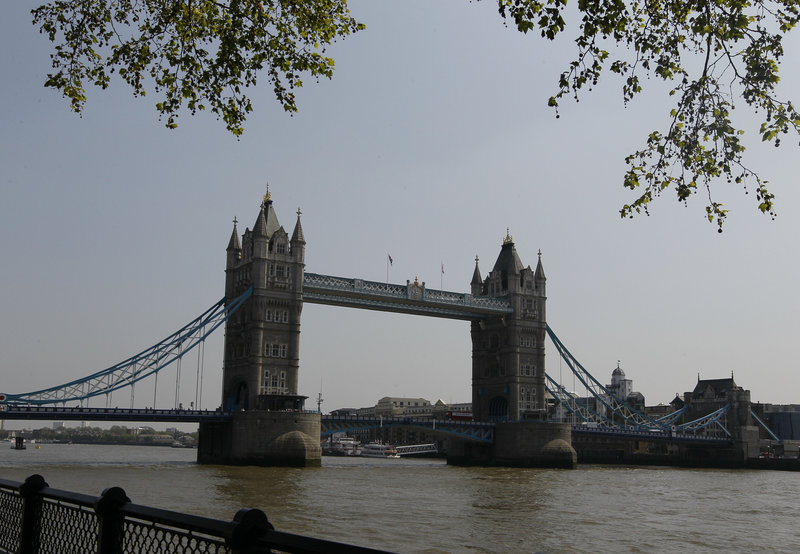 Tower Bridge is seen from near a cycle path in London. One route to Olympic Park starts at the Tower of London on the north side of the Thames River. It passes by historic port pubs such as The Prospect of Whitby, once home to sailors, smugglers and cutthroats.