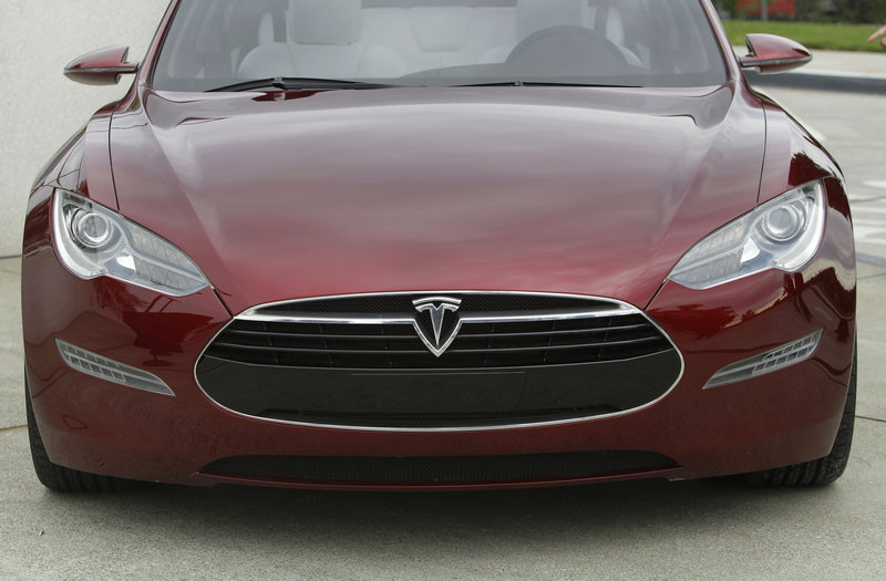 The Tesla Model S electric sedan is unveiled in October 2010 at the company's factory in Fremont, Calif. The Model S carries a starting price of $49,900 after a federal tax credit, about the same as a Lexus RX hybrid crossover.