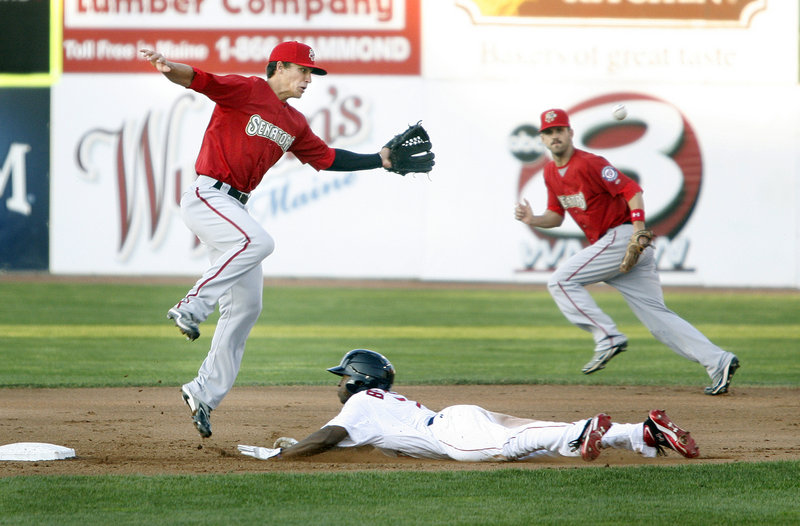 Jackie Bradley dives into second for a stolen base as Harrisburg shortstop Zach Walters chases the wild throw. Bradley was 1 for 4 in his first game with the Sea Dogs.