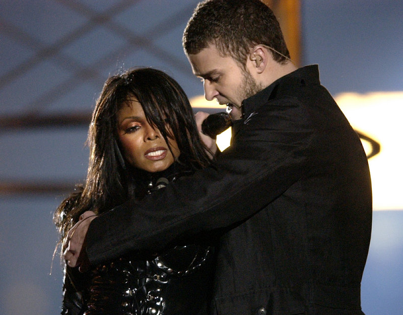 In this 2004 photo, Justin Timberlake and Janet Jackson sing at the Super Bowl, just before he pulled off the covering to her right breast, which was partially exposed.