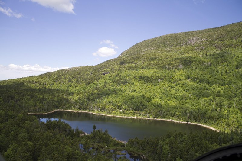 Remote Black Mountain Pond in Sandwich, N.H., is seen from a helicopter just before it lands so state wildlife officials can stock the waters with fingerling brook trout.