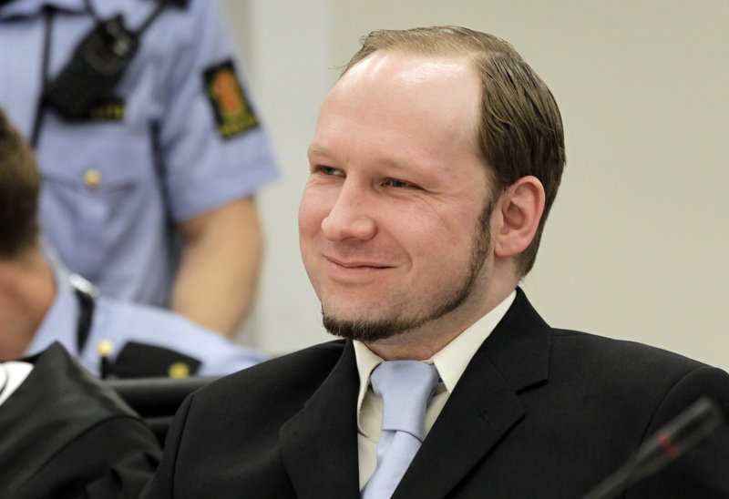 Anders Behring Breivik, the confessed killer of 77 people in Norway last year in a bombing and shooting rampage, reacts as prosecutors give closing arguments in Oslo on Thursday.