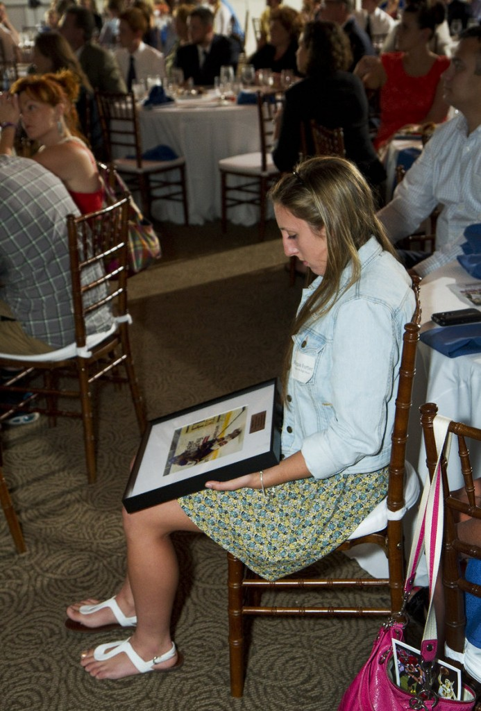 Megan Fortier of Falmouth, the girls' hockey player of the year, checks out her awards photo at the ceremony sponsored by the Portland Press Herald/Maine Sunday Telegram.