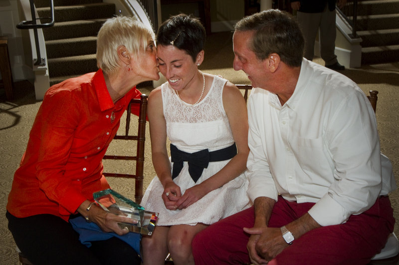 Abbey Leonardi of Kennebunk, one of the top cross country runners in the nation, is congratulated by her parents, Lynda and Jack, after being named the Portland Press Herald/Maine Sunday Telegram Female Athlete of the Year during the 25th annual all-sports awards ceremony Friday night at The Landing at Pine Point in Scarborough. Sam Dexter of Messalonskee was the male winner.