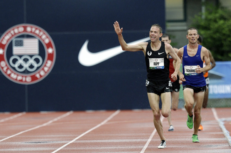 Galen Rupp waves to the crowd as he approaches the finish line of the 10,000 meters at the U.S. Olympic track and field trials Friday in Eugene, Ore. Rupp, a 2008 Olympian, won the race in 27 minutes, 25.33 seconds.