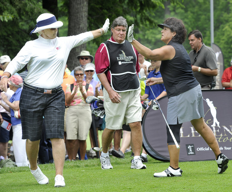 Pat Bradley, left, exchanges a high-five with Nancy Lopez. The two Hall of Famers drew the largest gallery but turned in disappointing first-round scores.