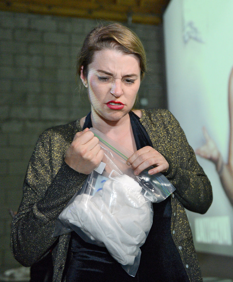 Tegan Artho-Bentz reacts after sniffing one shirt at the pheromone party.