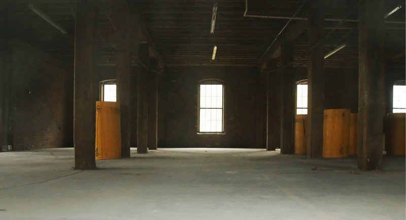 The ground floor of the Merrill's Wharf building on the Portland waterfront remains largely empty nine months after Pierce Atwood moved into the upper floors of the building.