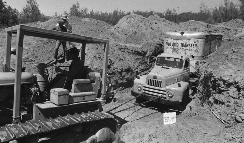 On July 20, 1976, officials remove a furniture van buried at a Livermore, Calif., quarry, in which 26 schoolchildren and their bus driver were held captive. They escaped unharmed. One of three men convicted in the case has been freed from prison.