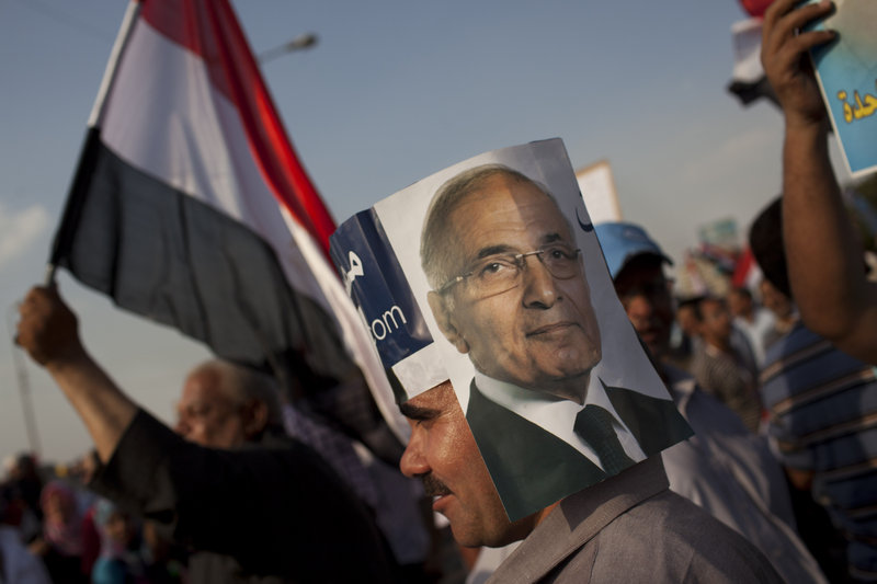 An Egyptian man wears a handmade hat with a picture of Egyptian presidential candidate Ahmed Shafik at a demonstration in Cairo, Egypt, on Saturday.