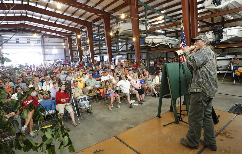 Matt Tinker of Copeland Plantation competes in the moose-calling competition as part of the Moose Lottery Festival in Oquossoc on Saturday.