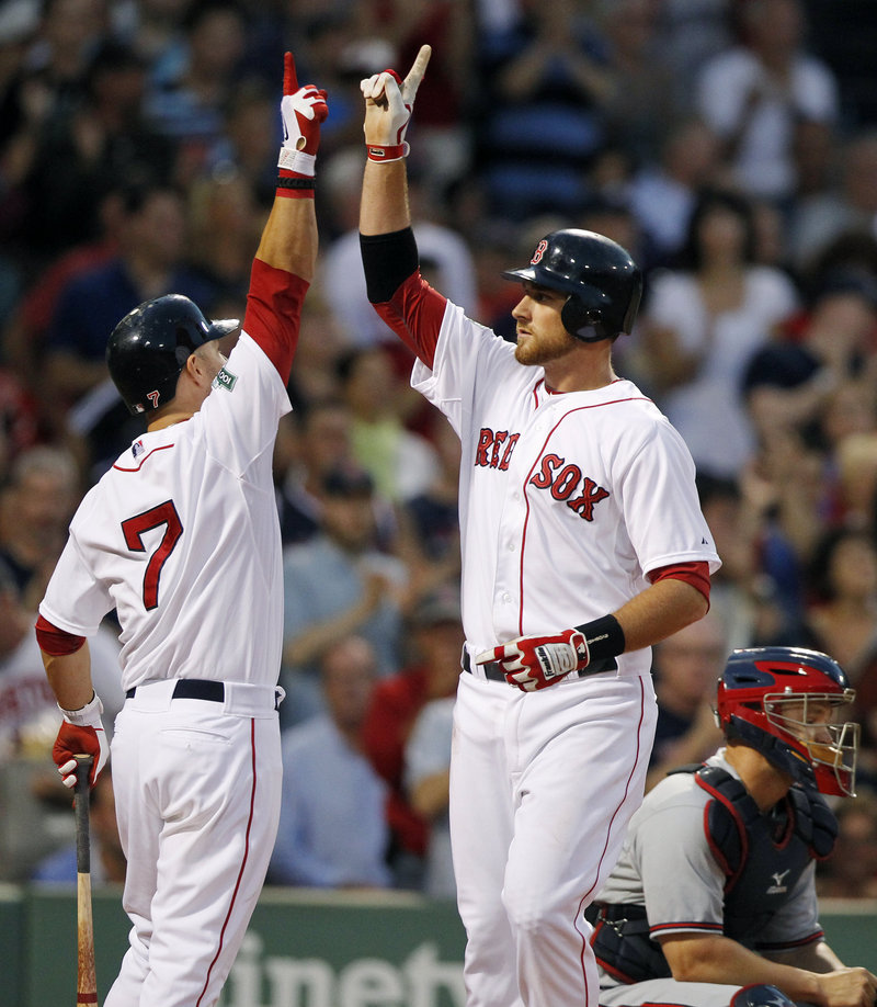 Will Middlebrooks, right, celebrates with Cody Ross after hitting a home run Saturday night, helping the Red Sox to an 8-4 win over the Braves.