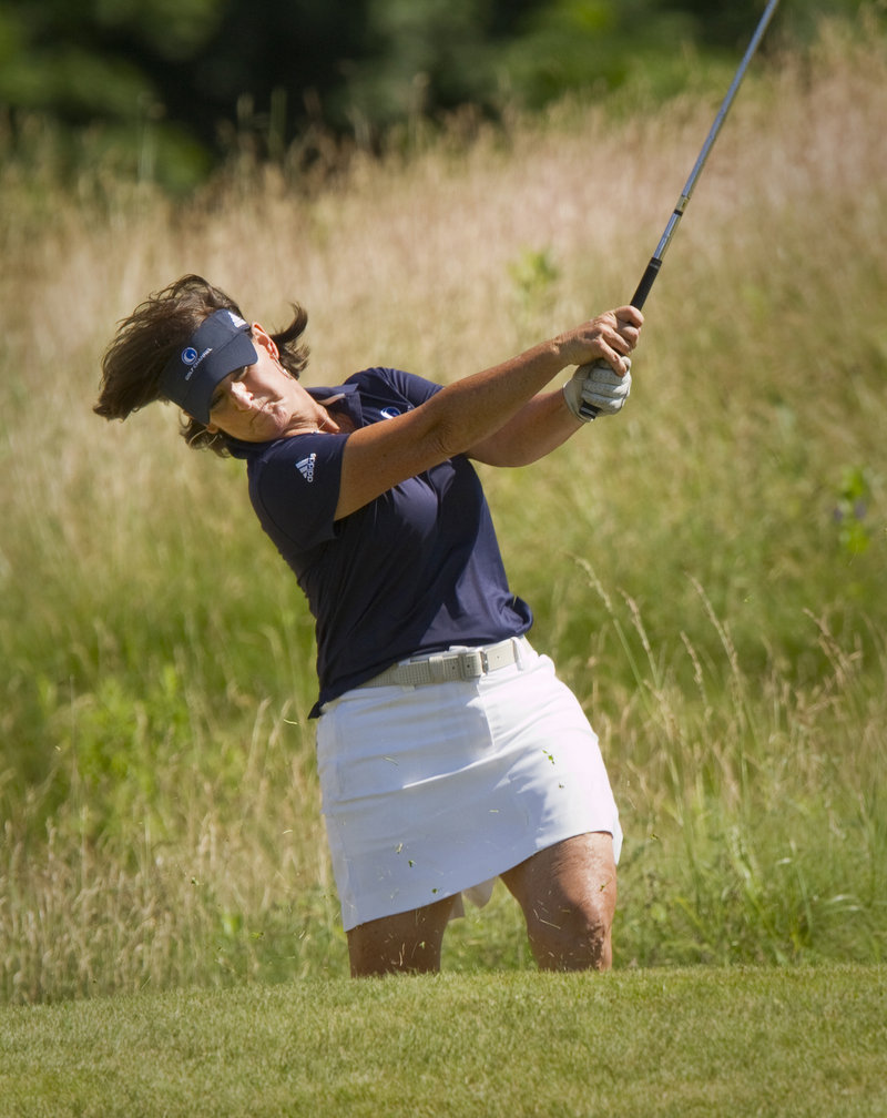 Val Skinner hits her approach shot on the 18th hole Sunday. Skinner shot a 71 for the second straight day and tied with Rosie Jones for second place at 2 under.