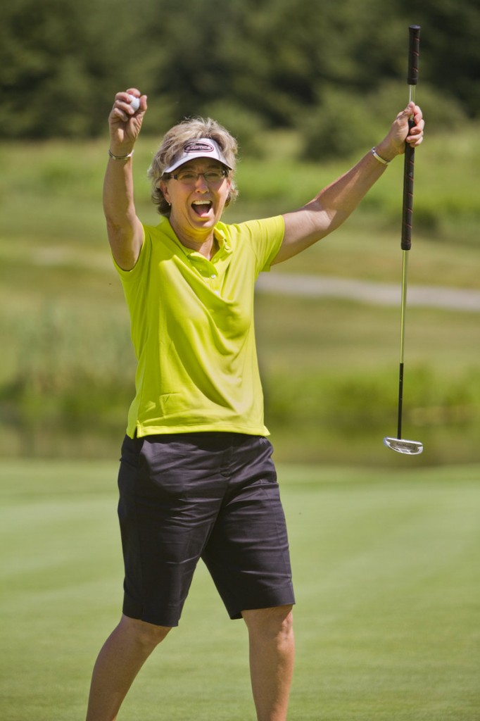 Sherri Turner celebrates after tapping in for par on the final hole to complete her victory in the Hannaford Community Challenge. Turner beat a field of 40 former LPGA Tour players with a 6-under 138 total.