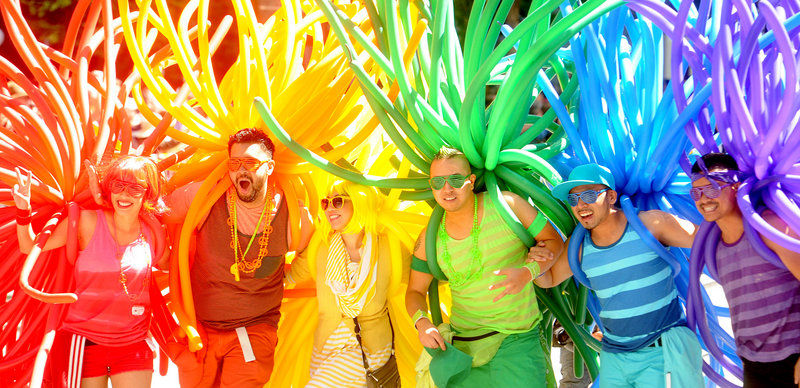 Revelers with balloons create a human rainbow during San Francisco's 42nd annual Gay Pride Parade on Sunday.
