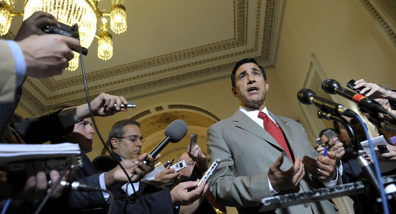 Rep. Darrell Issa, R-Calif., speaks to reporters in Washington last Tuesday. His GOP-led committee voted Wednesday to cite Attorney General Eric Holder for contempt of Congress.