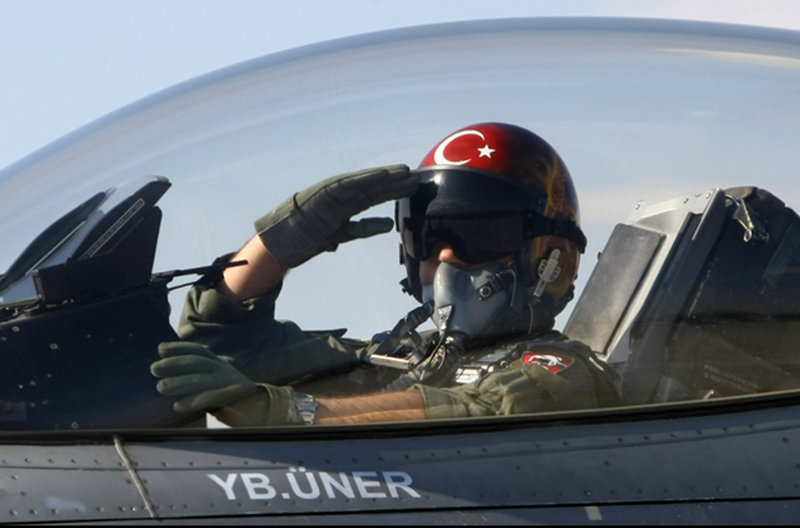 A Turkish pilot salutes before takeoff at an air base in Konya, Turkey, in 2010. Wreckage of a Turkish plane was found in the Mediterranean Sea, but the two pilots are still missing.