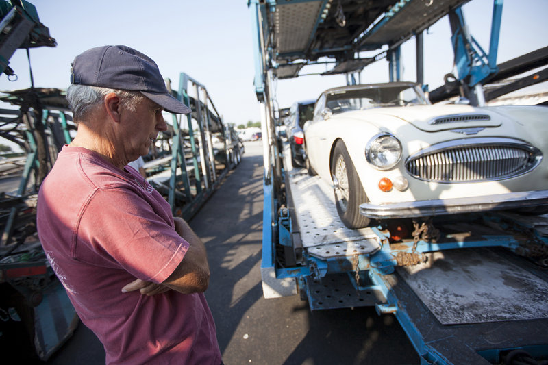 Bob Russell inspects his 1967 Austin Healey in Dallas on Saturday before the final leg of the vehicle's trip from California to Russell's home in Southlake, Texas.