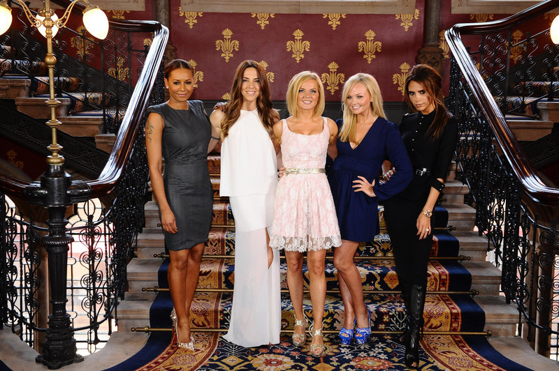 The Spice Girls, from left, Melanie Brown, Melanie Chisholm, Geri Halliwell, Emma Bunton and Victoria Beckham at a central London hotel Tuesday.