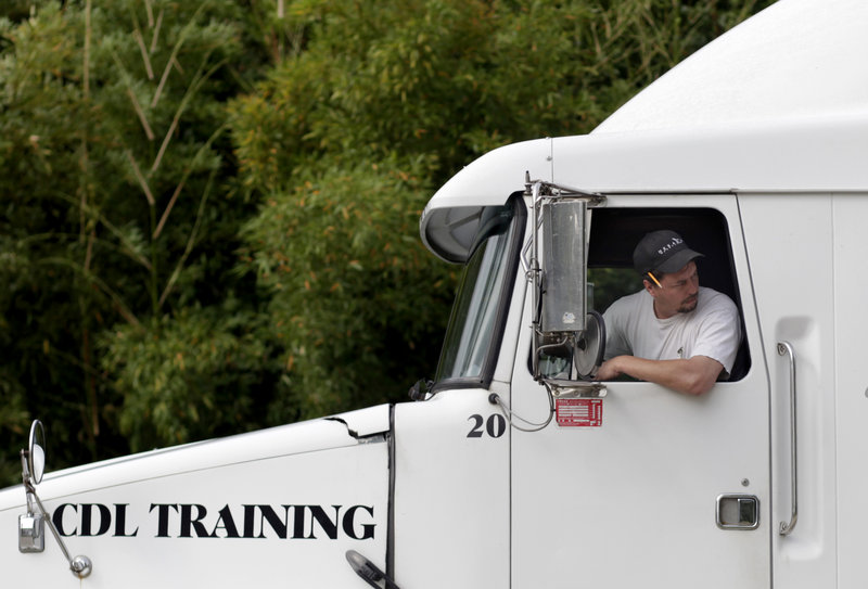 Robert Luckado practices a 45-degree backup maneuver during a skills class at the Carolina Trucking Academy training school in Raleigh, N.C., earlier this month.