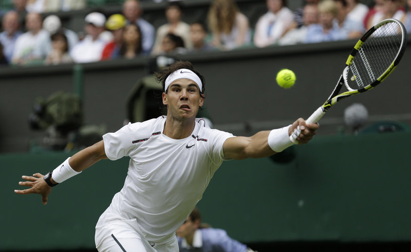 Rafael Nadal stretches for a return during a first-round match against Thomas Bellucci of Brazil. Nadal dropped the first four games of the match before finding his rhythm to win, 7-6 (0), 6-2, 6-3.