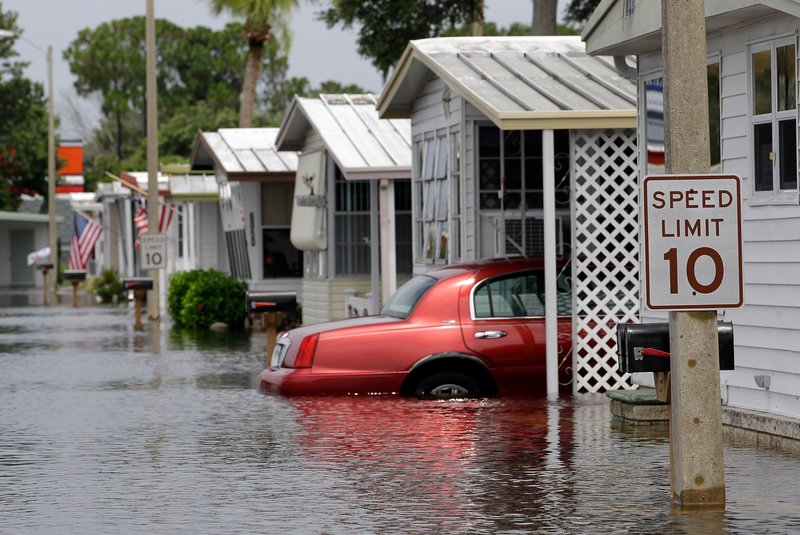 Standing water from Tropical Storm Debby floods the Suncoast Gateway Mobile Village, Tuesday in New Port Richey, Fla. Vacationers were wearing ponchos instead of swimsuits at the peak of the summer season because of the storm, which has drenched Florida for four days.