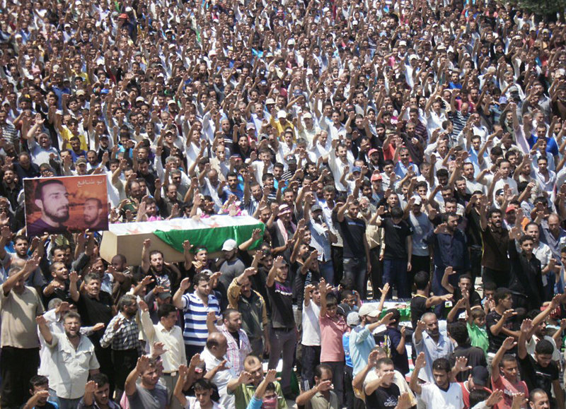 This image by a citizen journalist shows anti-Syrian regime mourners in Daraa, Syria, chanting slogans Tuesday as they carry the coffins of Syrian citizens who were killed.
