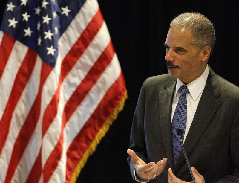 Attorney General Eric Holder speaks in Boston on Tuesday. The White House is defending him against a move in the House to hold him in contempt.