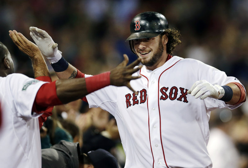 Red Sox catcher Jarrod Saltalamacchia celebrates after hitting a game-tying solo home run in the seventh inning against the Toronto Blue Jays.