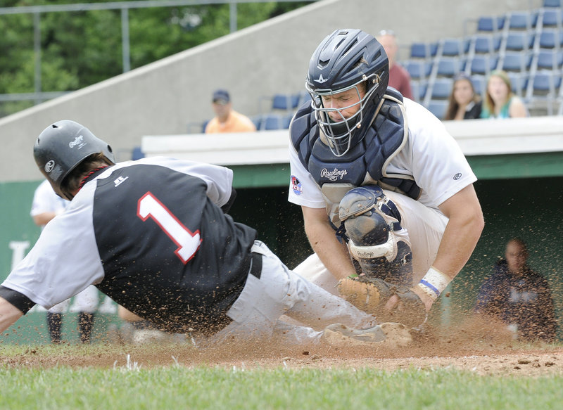 Matt Verrier, the catcher making the tag for the Old Orchard Beach Raging Tide, is one of the local players spending his summer playing baseball. Verrier, who plays at the University of Southern Maine, in high school helped Oxford Hills win a state championship.