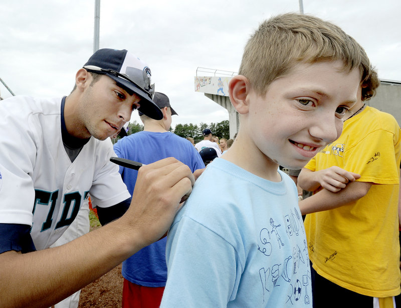 Sam Balzano, a Portland native, and the rest of the Raging Tide are happy to sign autographs – even on an ear lobe – including this one for 10-year-old Dylan Roberts of Steep Falls.