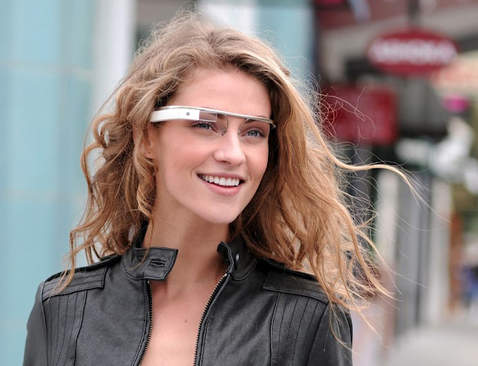 A woman wears a prototype of Google's Internet-connected glasses. Google is selling the device for $1,500 this week at its conference for software developers in San Francisco.