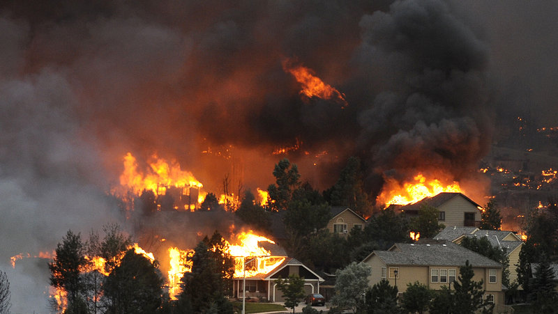 An entire neighborhood burns out of control near the foothills of Colorado Springs, Colo. in a photo taken Tuesday.
