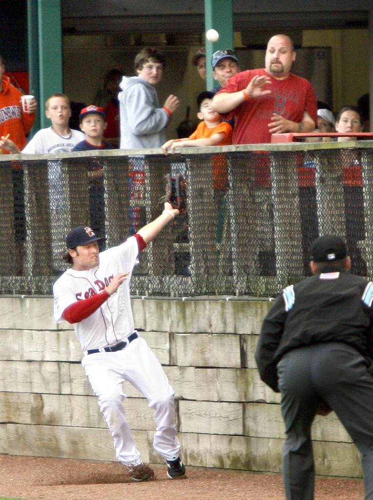 Bryce Brentz of the Portland Sea Dogs runs out of room Wednesday night while attempting to catch a foul ball along the right-field line during the 6-3 loss to the New Hampshire Fisher Cats at Hadlock Field.