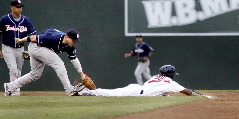 Jackie Bradley Jr. of the Sea Dogs is tagged out by Mark Sobolewski of New Hampshire after oversliding second base and getting caught in a rundown in the third inning.