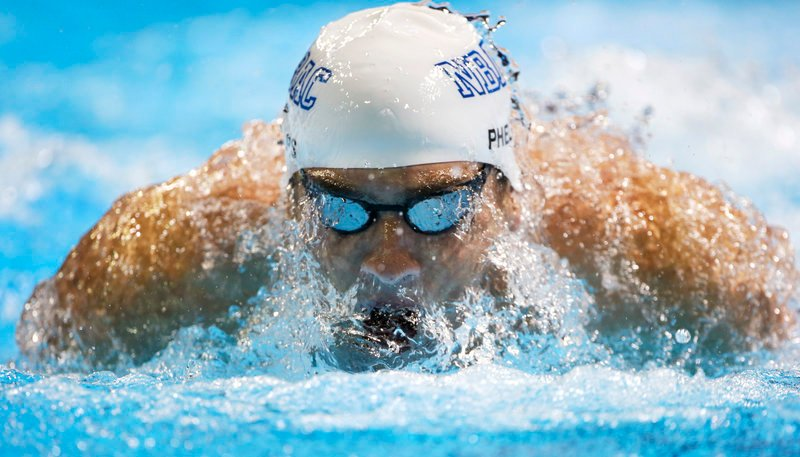 Michael Phelps swims in the men's 200-meter butterfly semifinal at the U.S. Olympic trials in Omaha, Neb. Wednesday. Phelps earlier beat Ryan Lochte in the 200-meter freestyle final.
