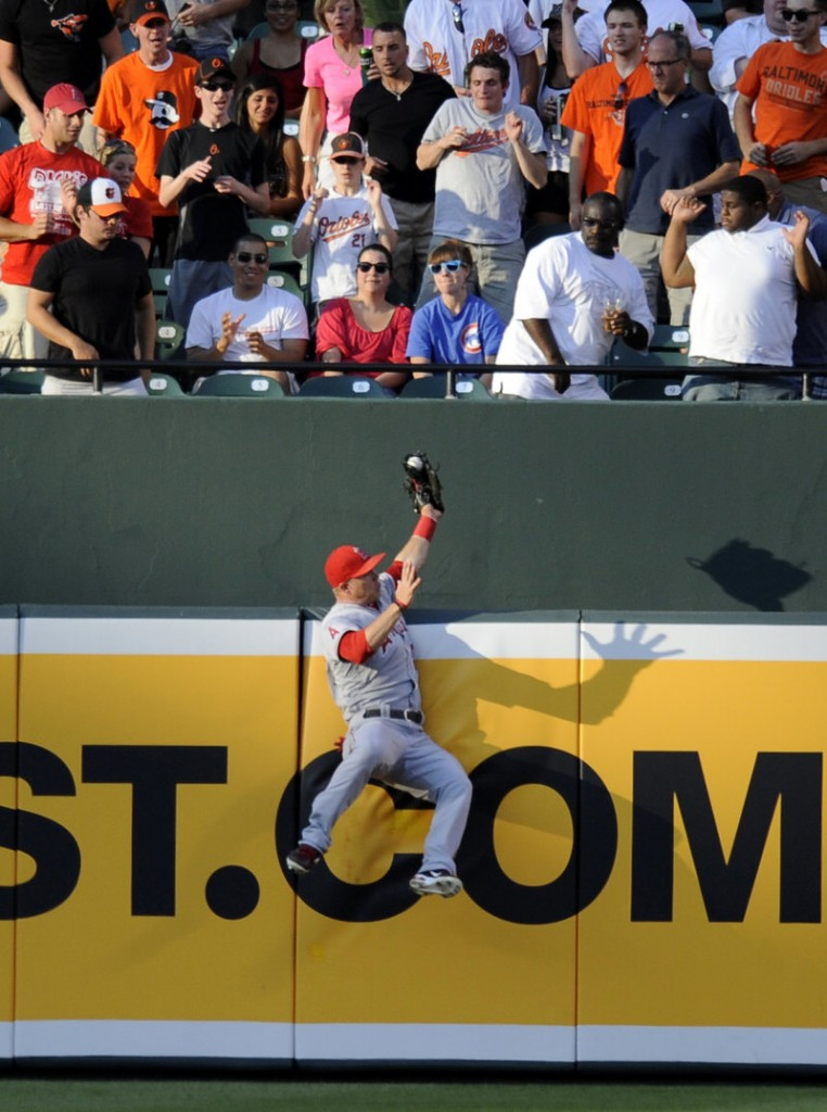 Mike Trout of the Los Angeles Angels robs J.J. Hardy of the Baltimore Orioles of extra bases during the first inning of the Angels' 13-1 victory at Baltimore Wednesday night.