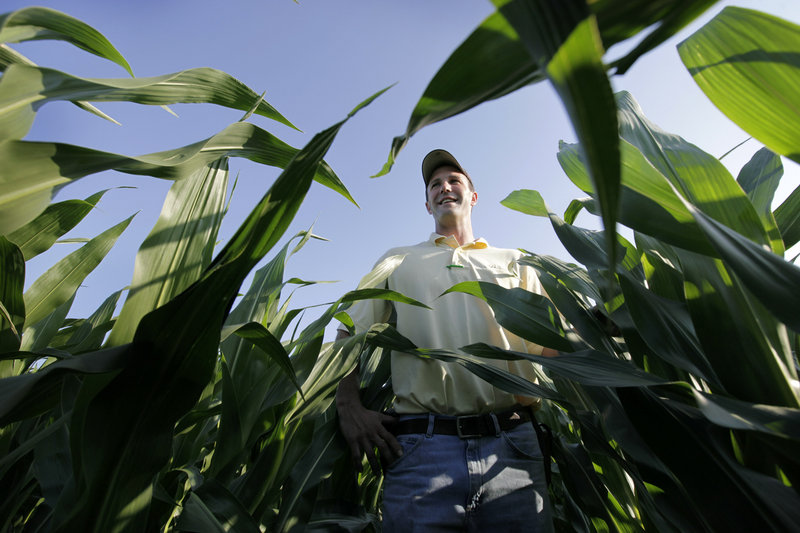 "Matt Danner stands in a corn field on his farm near Templeton, Iowa, earlier this month. Danner, part of a five-generation farm family, says he still recalls watching grown men cry at sales of failed farms. At 33, he says this is the best time to farm he's seen in 15 years. ""It takes 10 good years to fix the five bad ones of the '80s,"" he said. ""It's going to go the other way. It always does. There's plenty of history to prove it's not going to last long."""